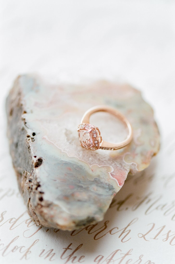 Closeup of a luxury designer engagement ring by Brian Gavin placed on a geode