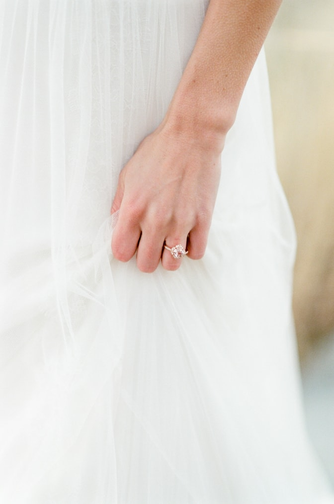 Closeup of a hand with a luxury designer engagement ring by Brian Gavin