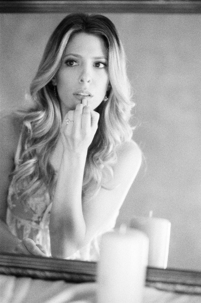 Bride during her boudoir session showcasing her luxury designer engagement ring by Brian Gavin