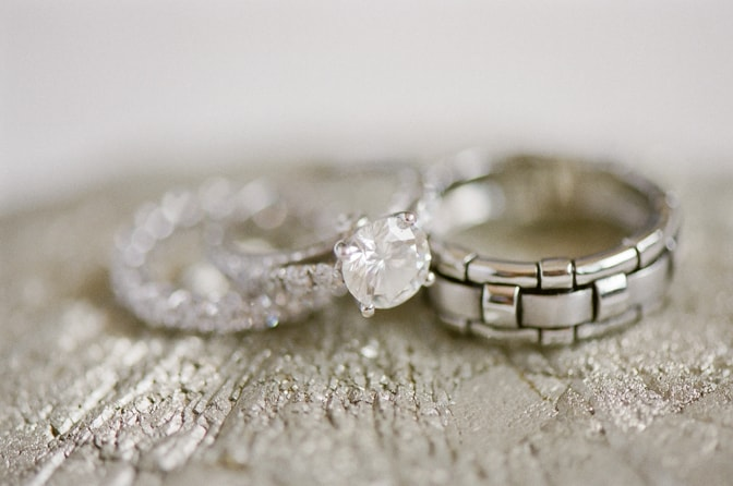 Closeup of luxury designer engagement ring and bands by Tiffany & Co