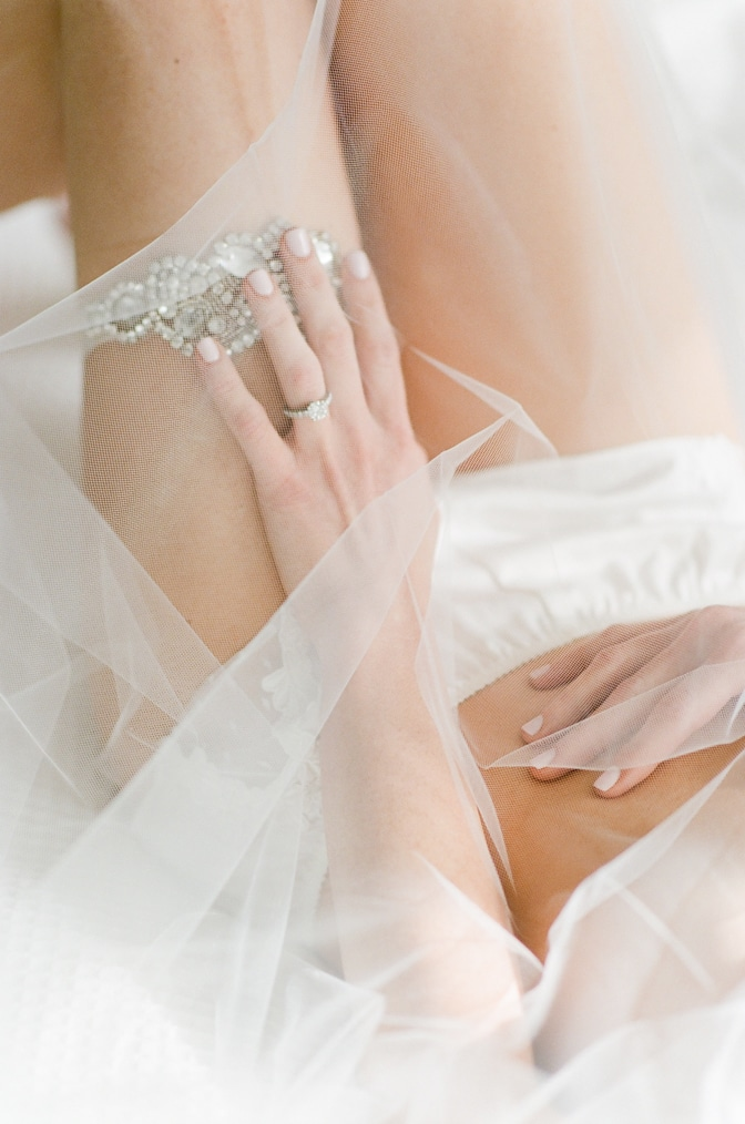 Closeup of a hand with a luxury designer engagement ring by Tiffany & Co