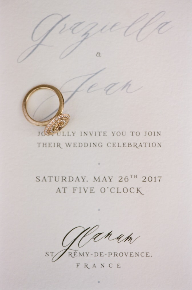 Luxury designer engagement ring by Michaela Roemer placed on top of an invitation suite