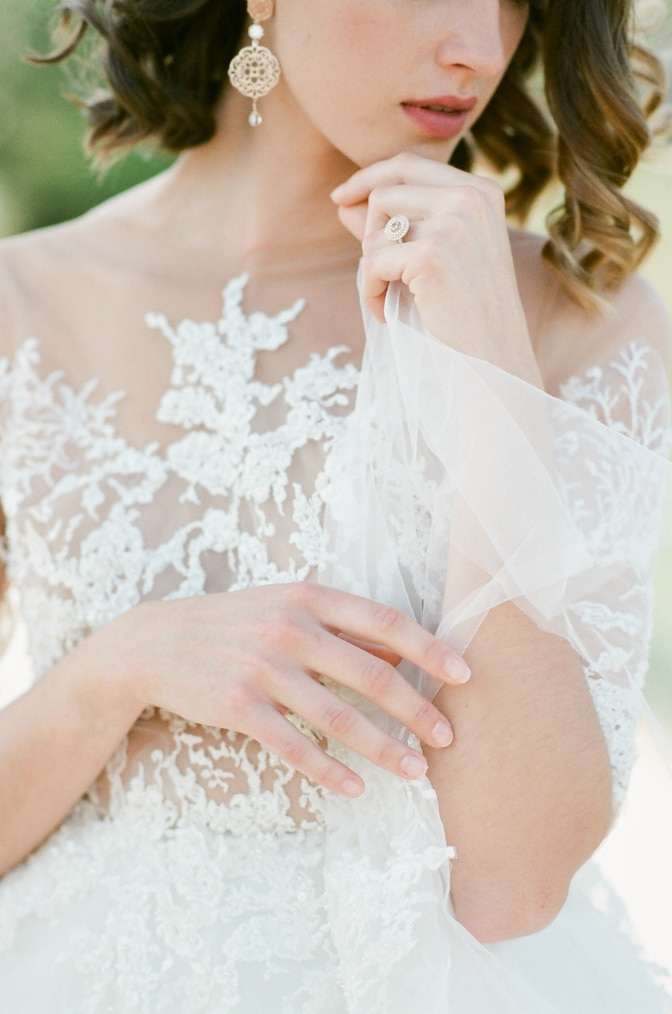 Closeup of a bride and her fine jewelry by Michaela Roemer