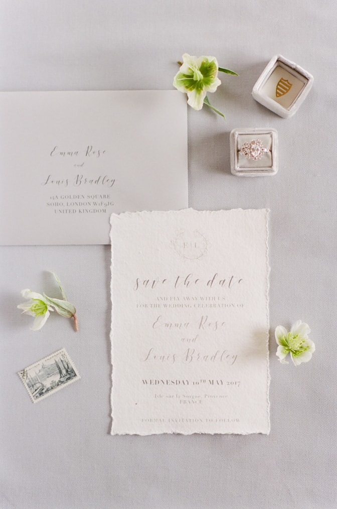 Closeup of invitation suite and fine jewelry details