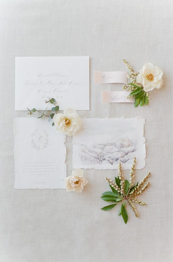 Flatlay of Jolie and Company's luxury romantic wedding invitation