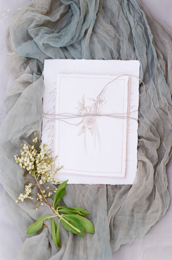 Closeup of a luxury romantic wedding invitation with plant drawing