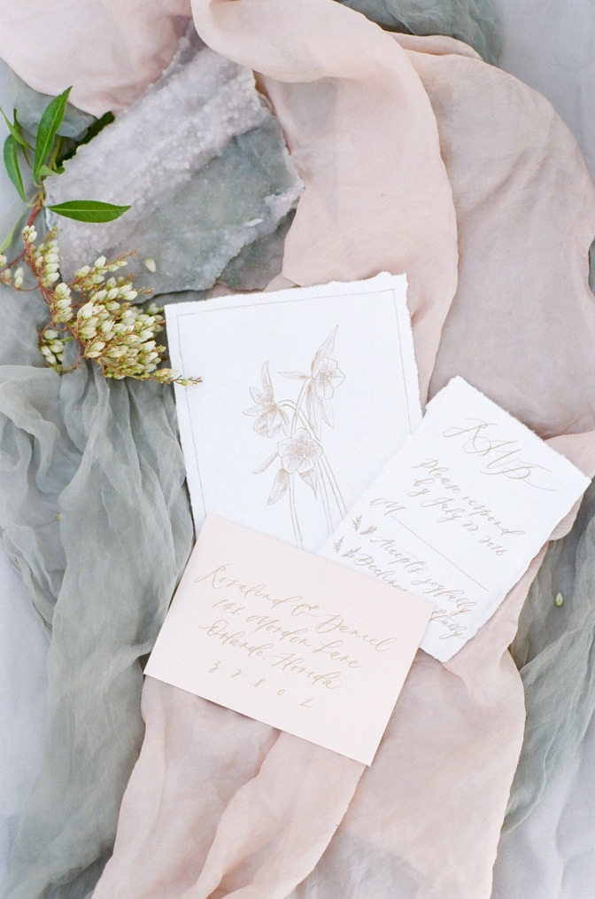 Closeup of luxury romantic wedding invitation photographed by luxury destination wedding photographer Tamara Gruner