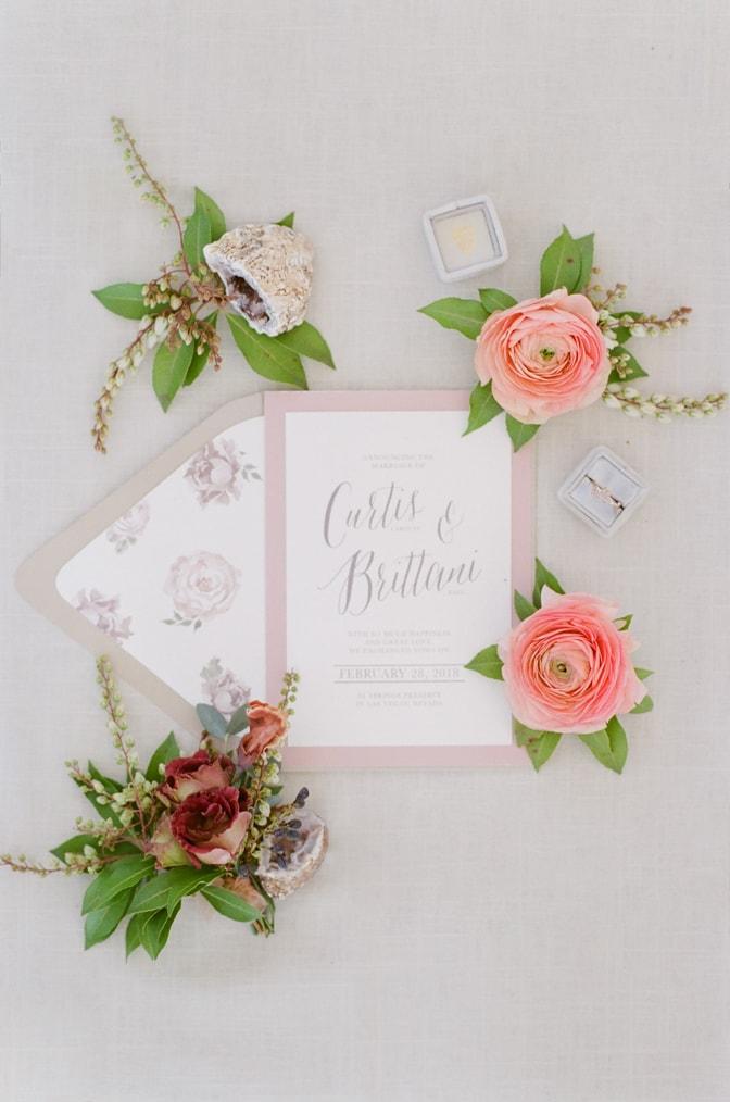 Flatlay of luxury romantic wedding invitation