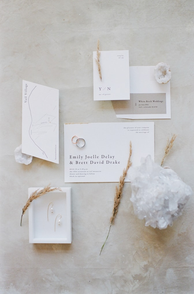 Flatlay of modern luxury letterpress wedding invitation
