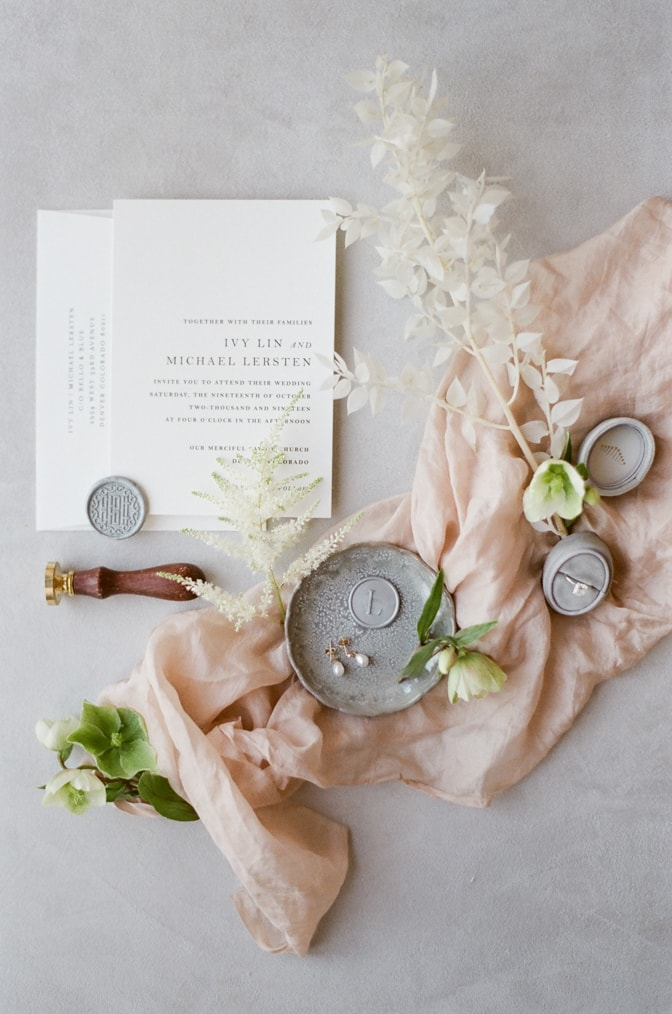 modern and romantic wedding invitation decorated with blush silk and flowers