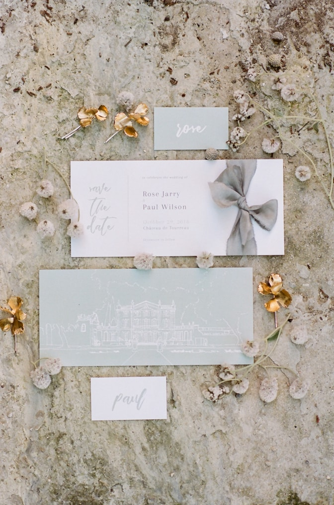 Modern luxury wedding invitation surrounded by jewelry