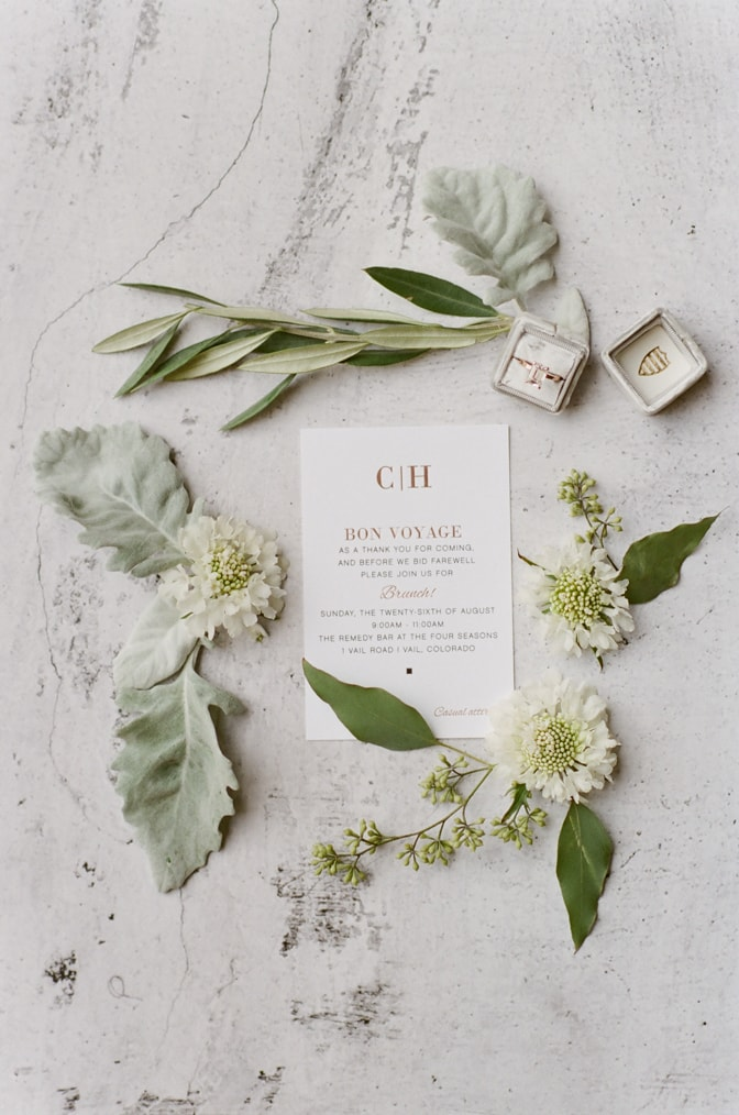 Closeup of Modern luxury wedding invitation surrounded by flowers