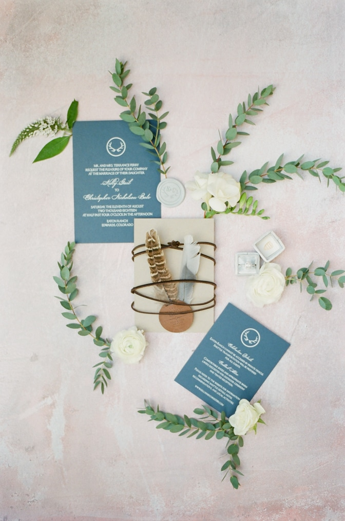 Modern luxury wedding invitation with feathers and flowers