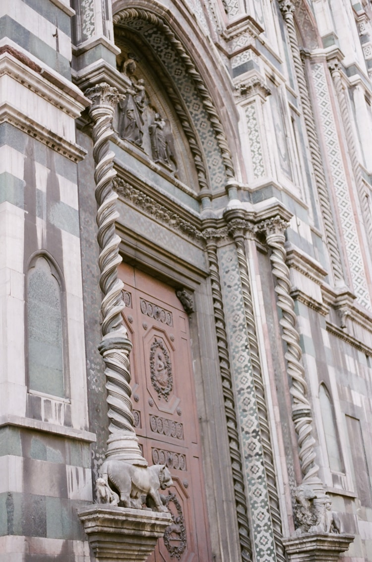 Closeup of a door of the Cathedral in Florence with its beautiful white and green marble tiles
