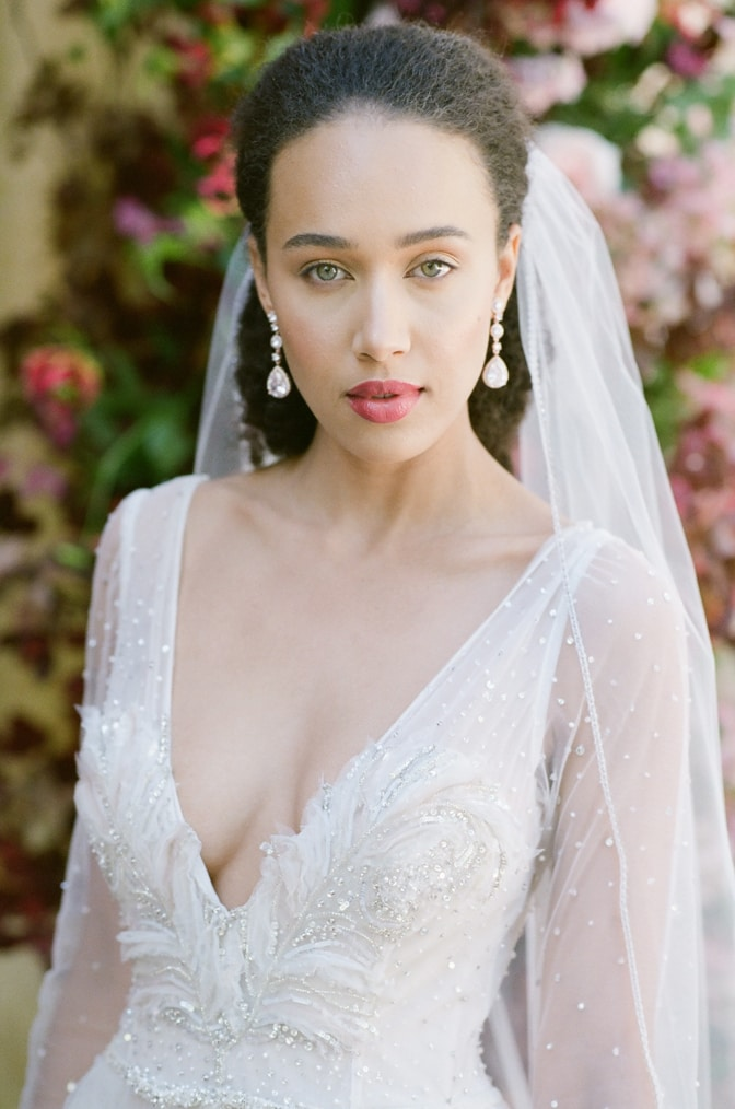 Black bride with green eyes in her blush Inbal Dror wedding gown at Chateau Martinay