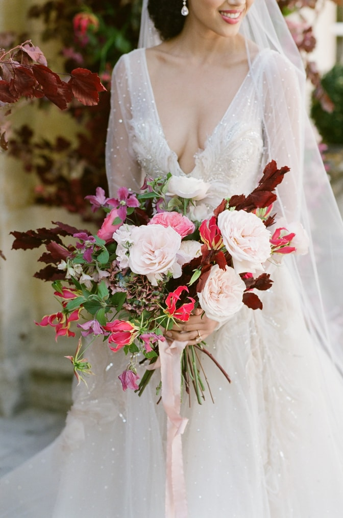 Closeup of a wedding bouquet in blush and red at Chateau Martinay in Provence