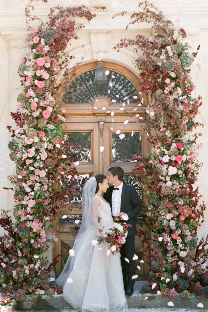 Bride and groom kissing after saying 'yes' to each other during their wedding ceremony at Chateau Martinay in Provence