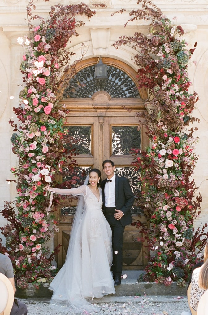 Bride and groom the moment after saying 'yes' to each other under their ceremony arch at Chateau Martinay in Provence