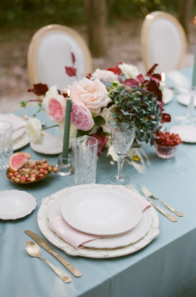 Floral wedding centerpiece in blush, red and blue at Chateau Martinay in Provence