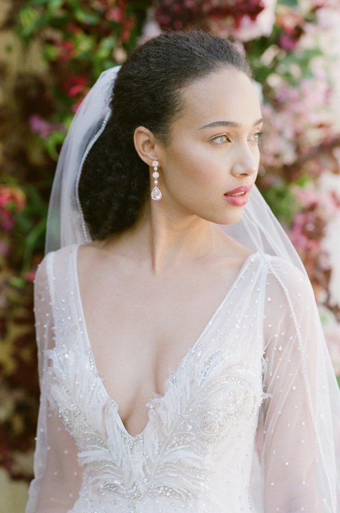 Closeup of a black bride looking away from the camera at Chateau Martinay in Provence