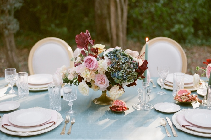Closeup of a flower centerpiece in blue, blush and red at Chateau Martinay in Provence