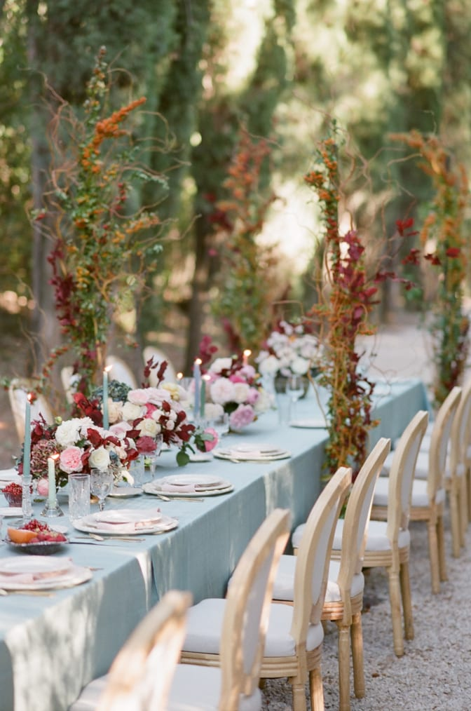 Wedding reception table in blue, blush and red colors at Chateau Martinay in Provence
