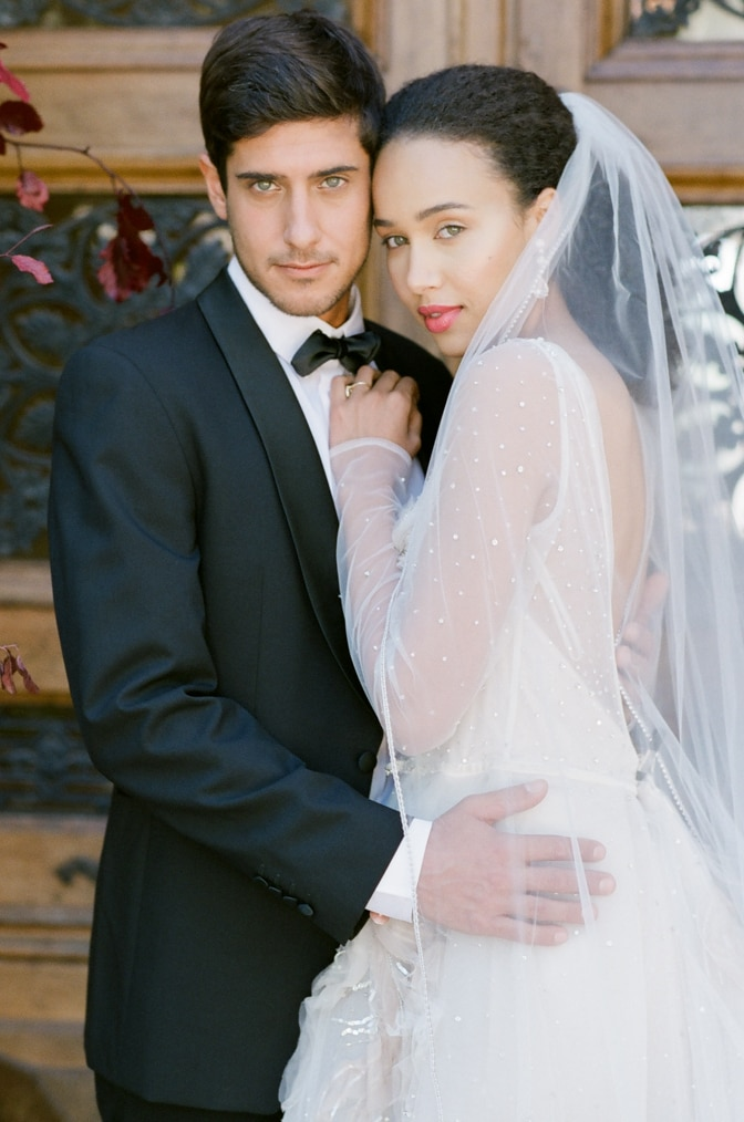 Bride and groom embracing each other at Chateau Martinay in Provence