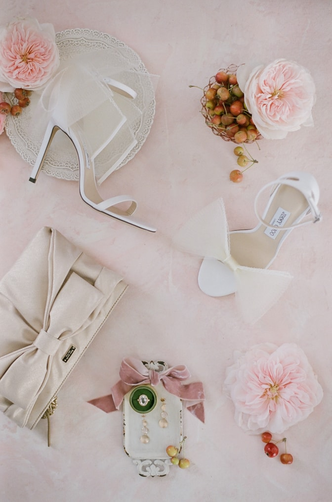 Closeup of white Jimmy Choo shoes with a bow
