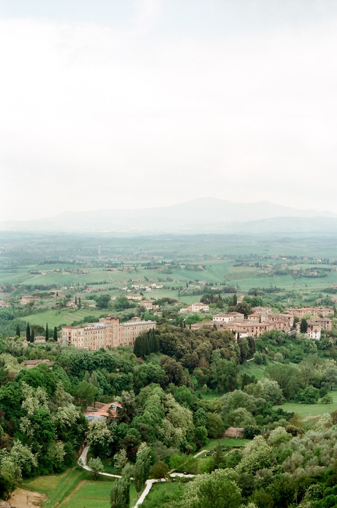 Aerial view of the city Siena in Italy with rolling hills in the background