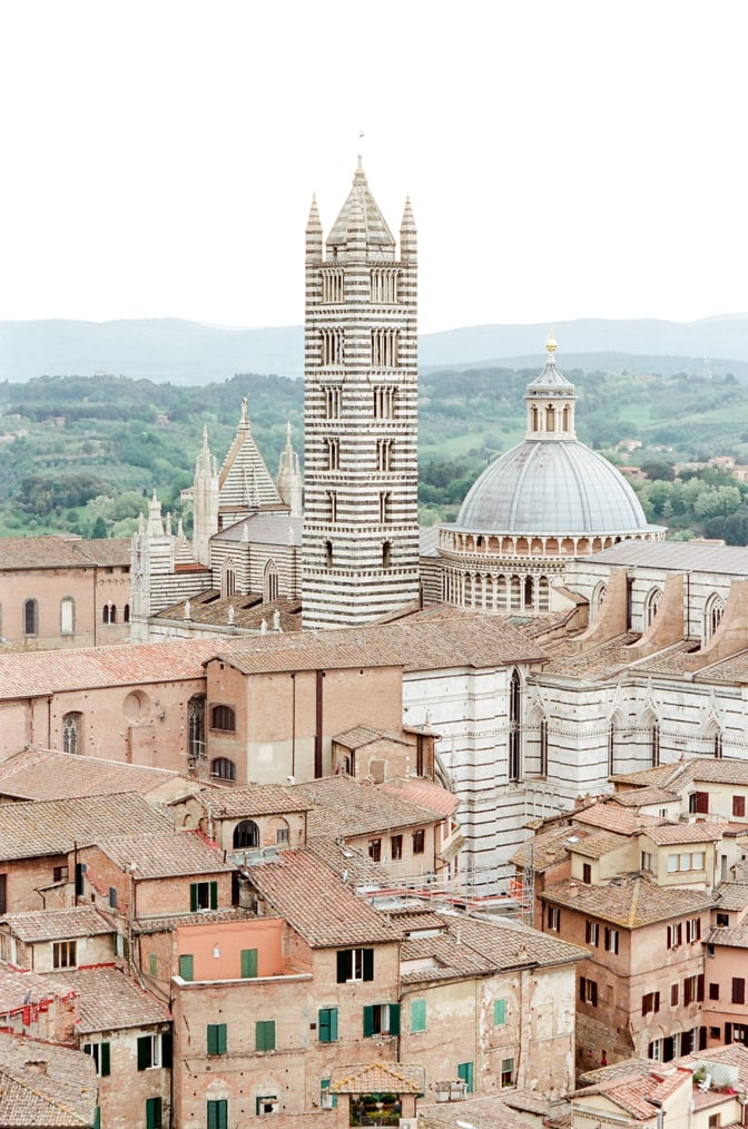 The Cathedral and its black and white marbled tower in Siena Italuy