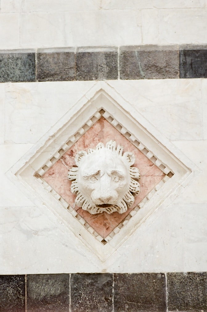 Closeup of lion's face at Piazza del Campo in Siena Italy