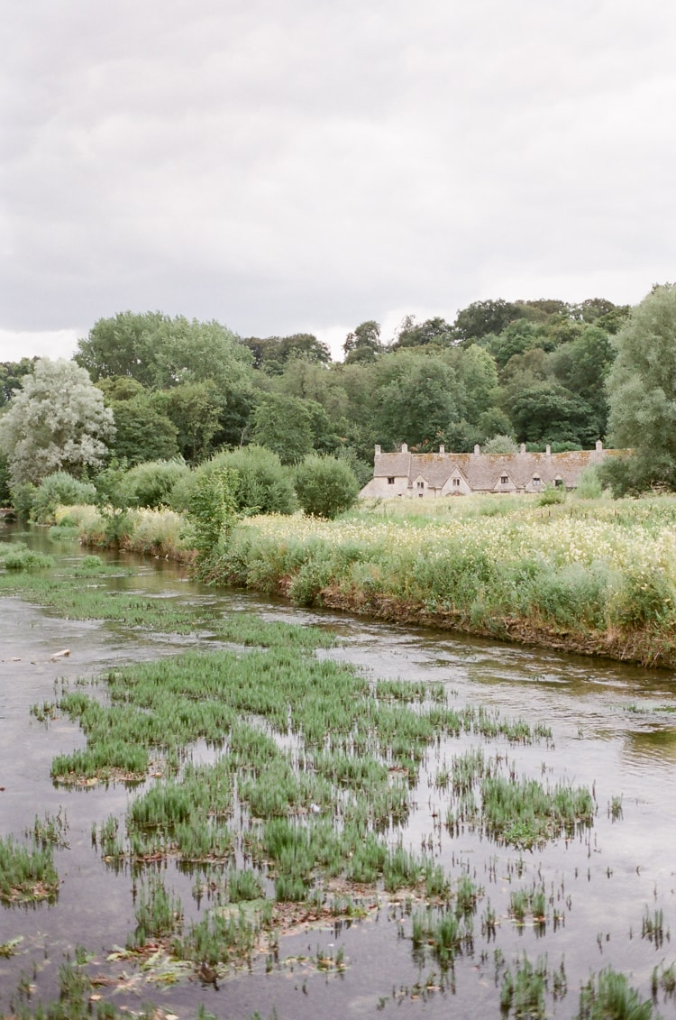 Bibury and its Arlington Row at River Coln in the Cotswolds in England