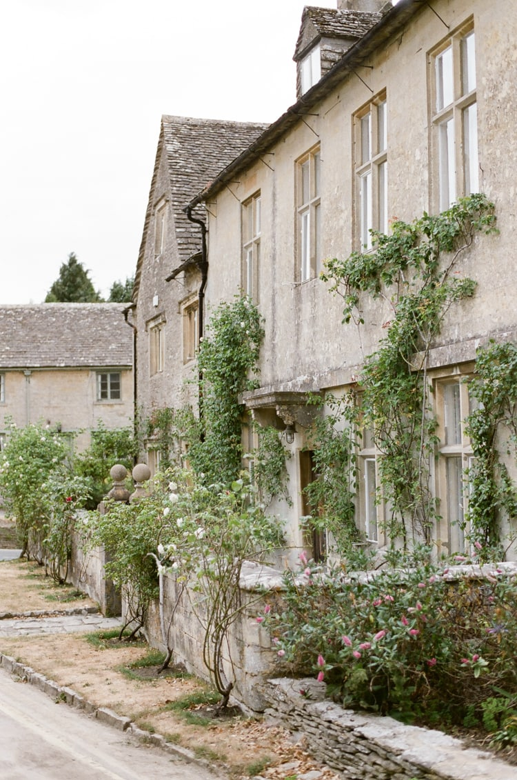 Golden-colored Cotswold stone house in Bibury in the Cotswolds in England