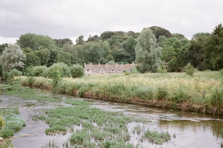 Arlington Row in Bibury, a rowof beautiful weaver's cottages in the Cotswolds in England