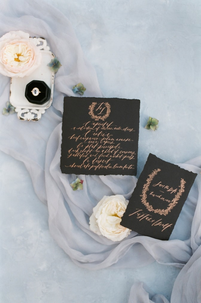 Closeup of black invitation suite from Yonder Design