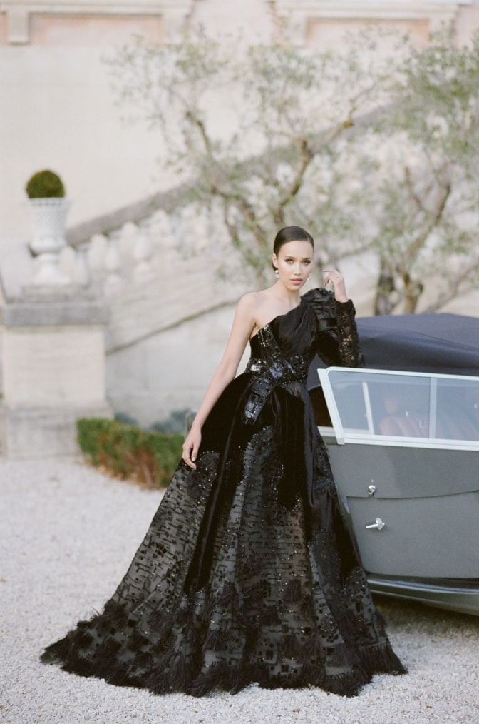 Black bride in her black haute couture Ziad Nakad gown leaning on a grey Rolls Royce at Chateau Martinay in Provence