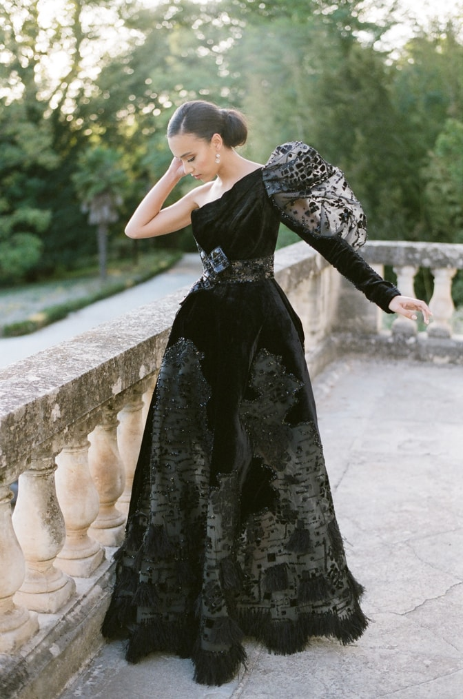 Black bride in her black Ziad Nakad couture gown dancing on the terrace of Chateau Martinay in Provence