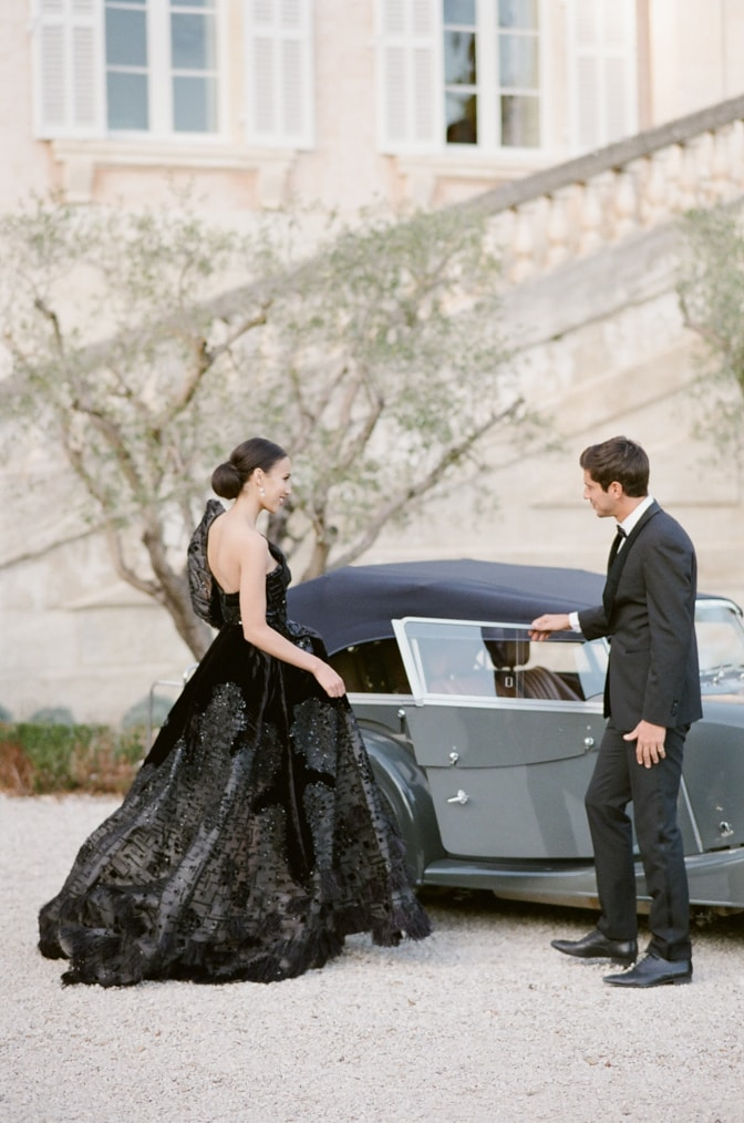 Groom opening the car door for his bride at Chateau Martinay in Provence