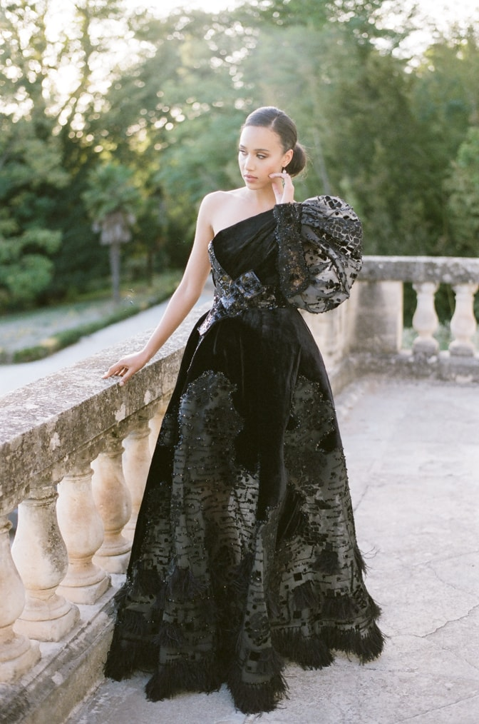Black bride in her black Ziad Nakad couture gown standing on the terrace at Chateau Martinay in Provence