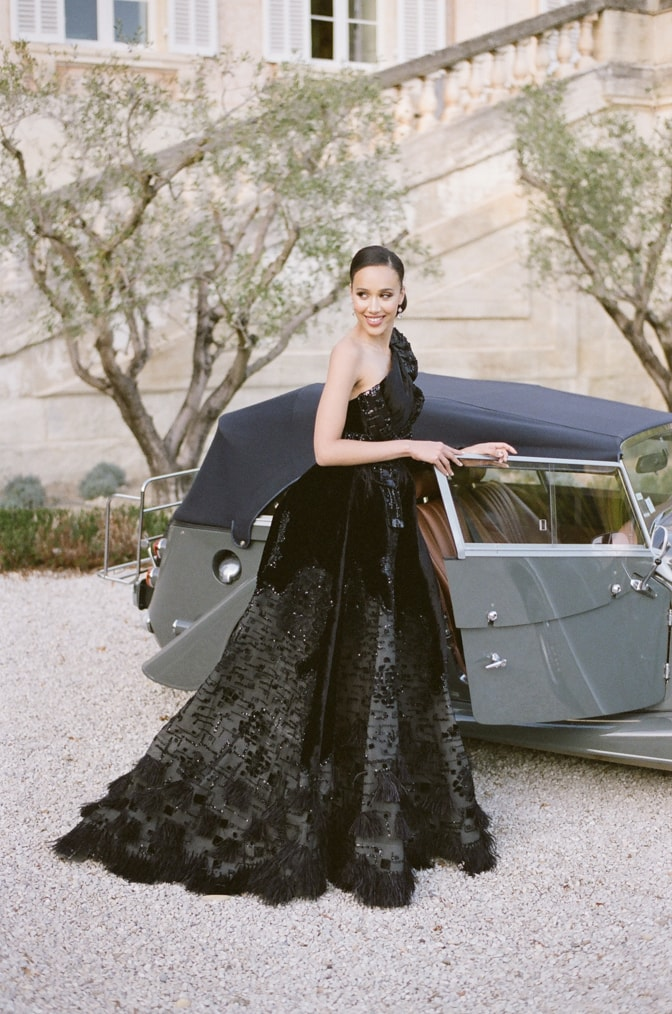 Black bride in her black Ziad Nakd couture gown entering a grey Rolls Royce at Chateau Martinay in Provence