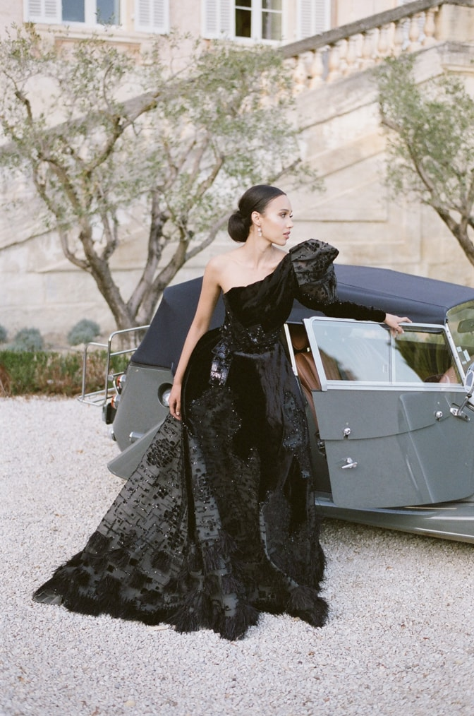 Black bride in her black Ziad Nakad gown in front of a grey Rolls Royce at Chateau Martinay in Provence