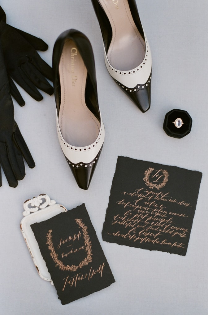 Closeup of black and white Christian Dior couture shoes