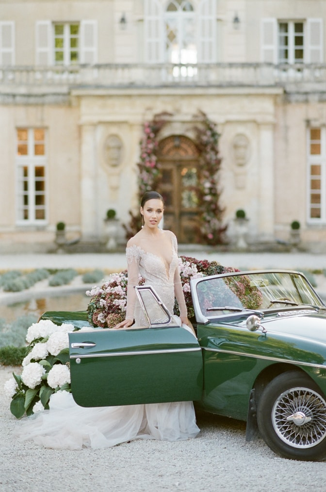Planning your grand exit for your wedding day in a green car filled with hydrangea