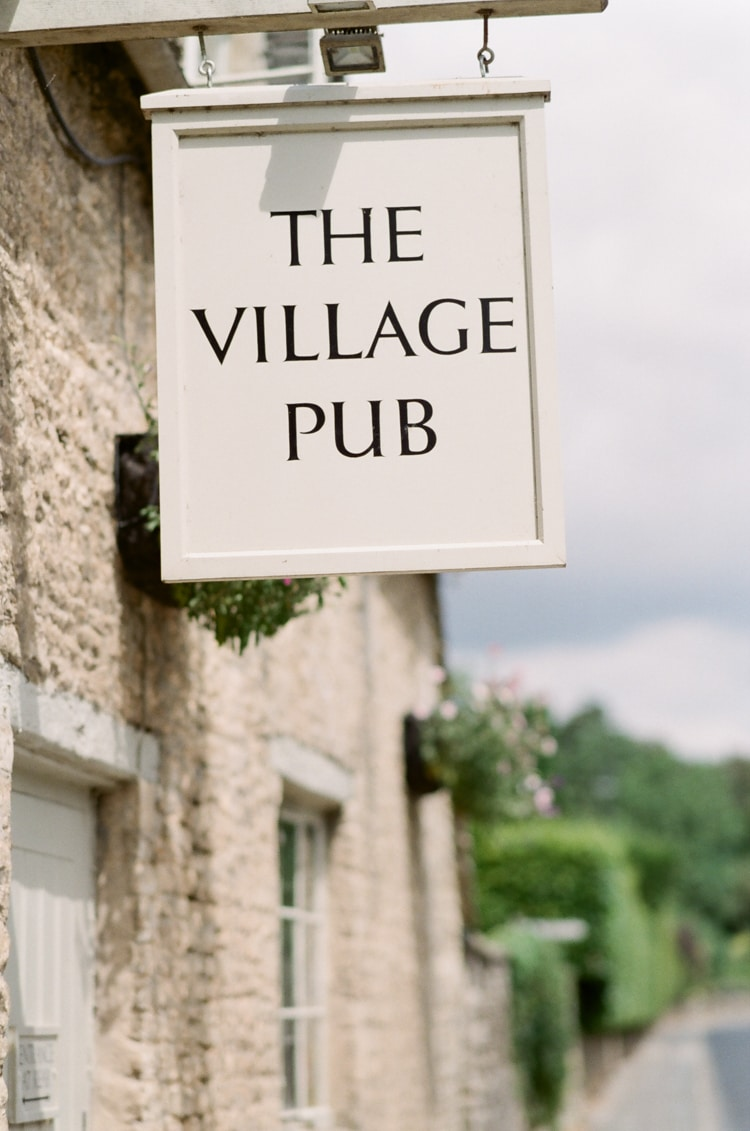 Sign of the Village Pub in Cirencester in the Cotswolds in England