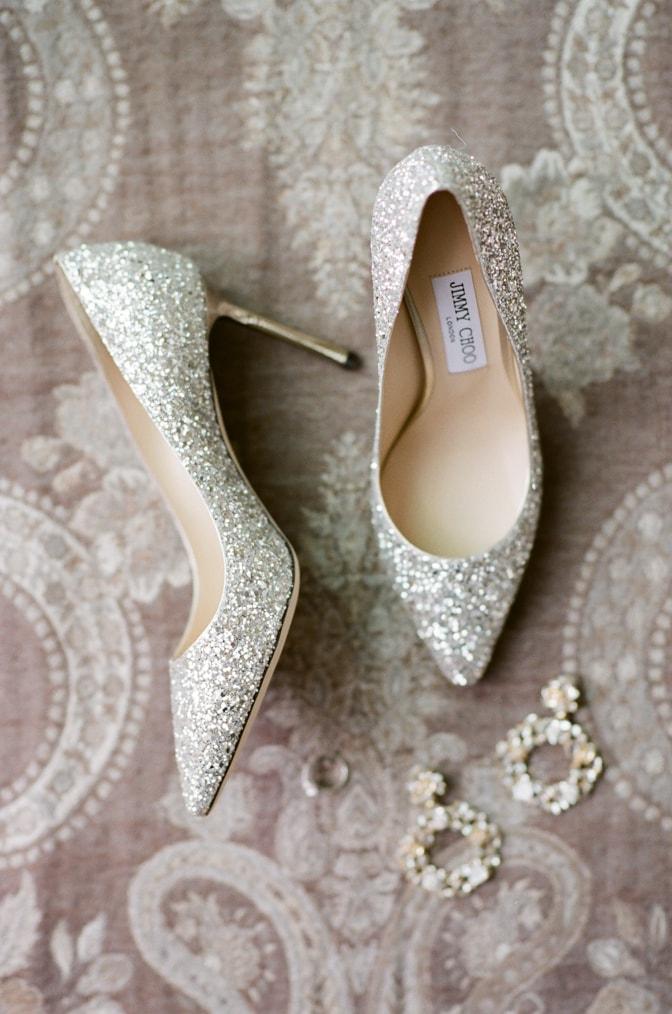 Luxury wedding shoes of Jimmy Choo in silver glitter