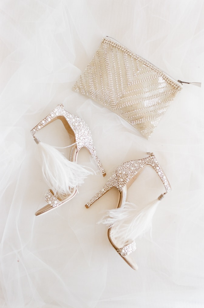 Luxury wedding shoes of Jimmy Choo with white pearls and feather accents