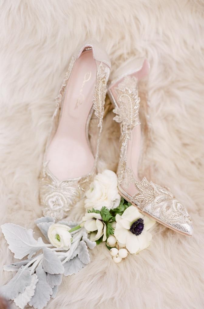 Gold lace Oscar de la Renta wedding shoes on white faux fur