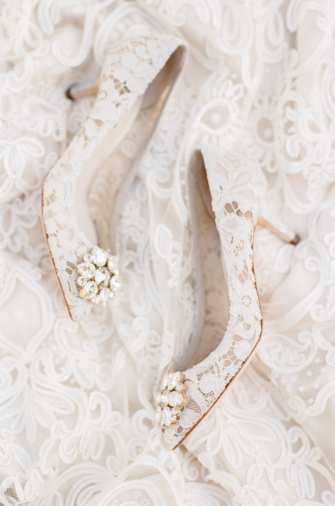 White lace Manolo Blahnik wedding shoes from the side