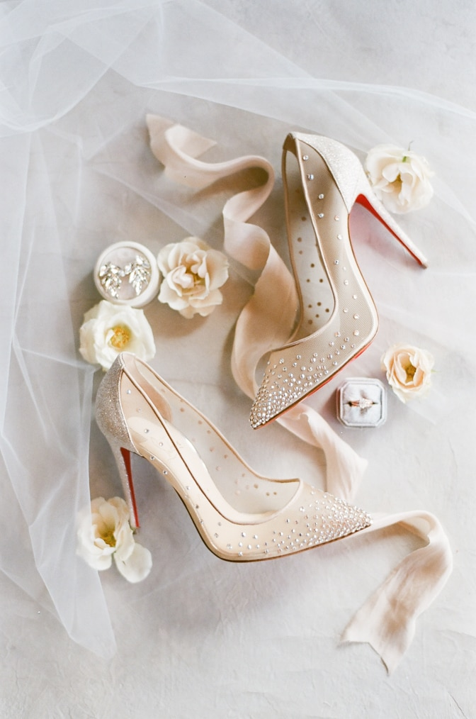 Blush Louboutin shoe pair with crystals