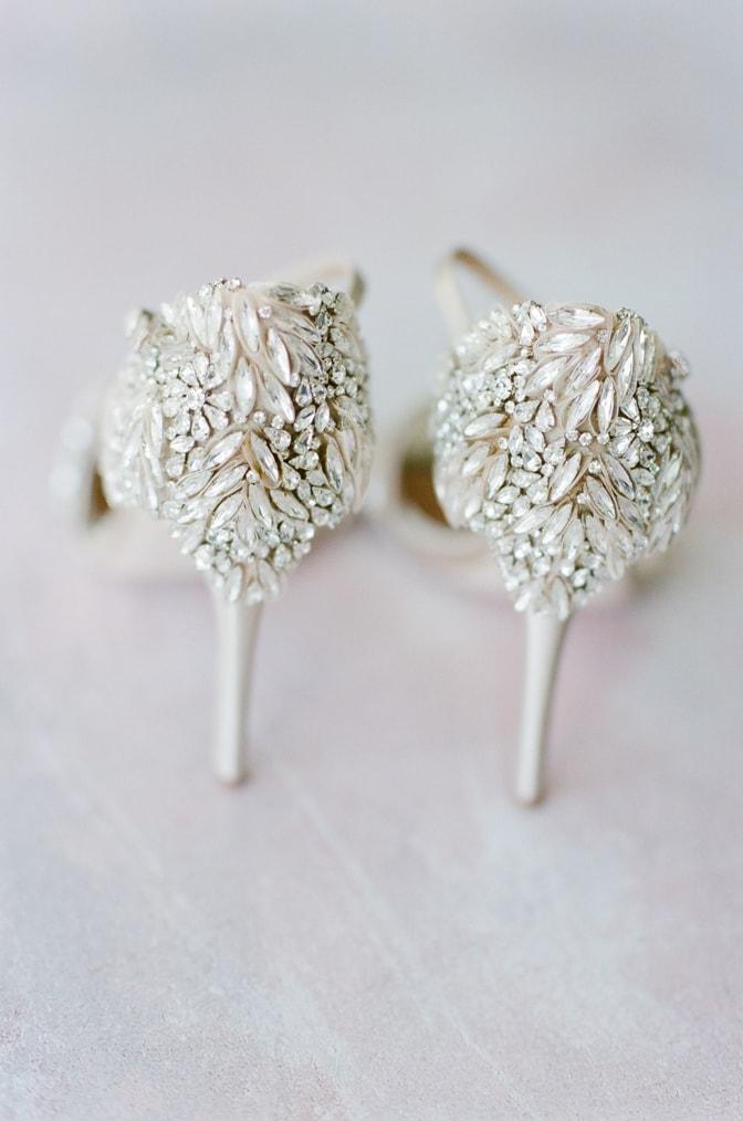 Backside of luxury Badgley Mischka wedding shoes adorned with crystals
